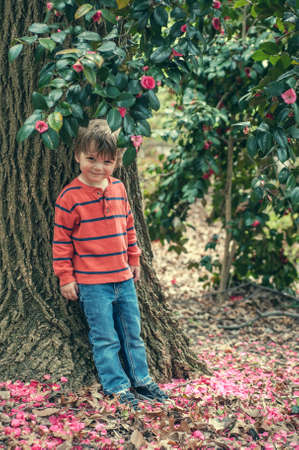 Toddler boy portrait outdoors photo