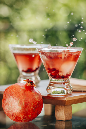 Pomegranate martinis served in an outdoor setting