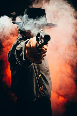 cowboy man: Gunslinger in the shadows