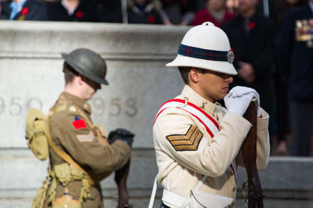 Toronto, Canada - November 11, 2012  Soldiers stand vigil during Remembrance Day Services at Old City Hall Cenotaph