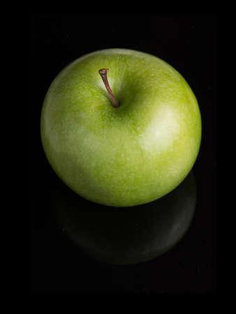 Green apple over the black Archivio Fotografico