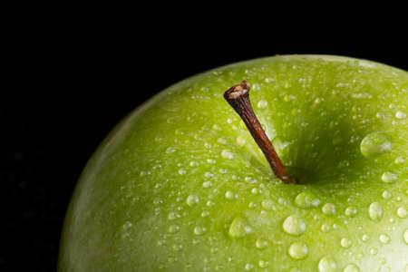 Green apple on the black