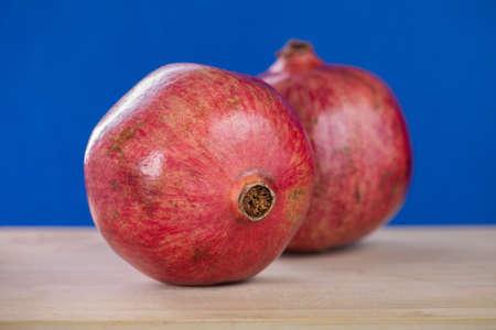 Two Pomegranates on the blue background 版權商用圖片