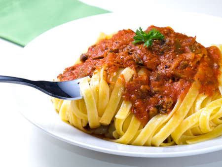Homemade fettuccine bolognese photo