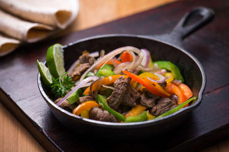 pans: Beef fajita in the pan with tortilla bread  Stock Photo