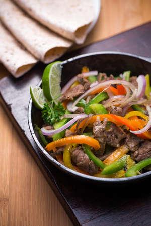 fajita: Beef fajita in the pan with tortilla bread  Stock Photo