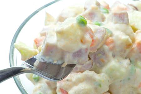 Close-up of a bowl of fresh Russian salad Standard-Bild