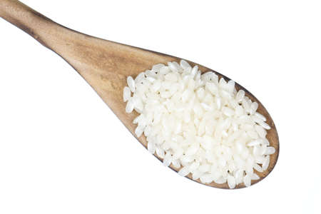 Closeup overview of rice in a wooden spoon photo
