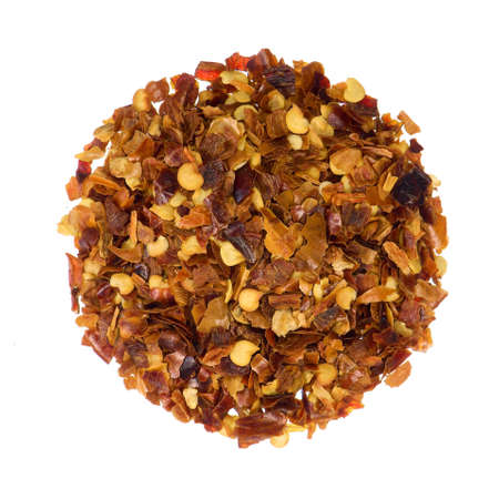 heap: Closeup overview of crushed red pepper isolated on white