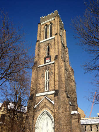 gothic church: St. George the Martyr Anglican Church in Toronto, Canada on a blue-sky day Stock Photo