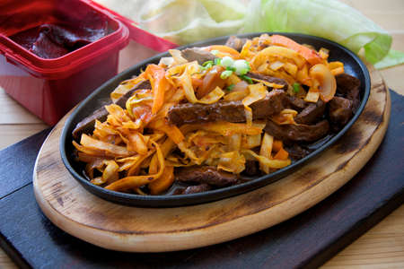 Steaming hot pan fried steak with Korean chilli sauce photo