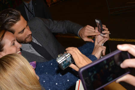TORONTO - SEPTEMBER 6: Actor Jake Gyllenhaal takes a selfie with fans at the Toronto International Film Festival for his new film Prisoners on September 6, 2013.