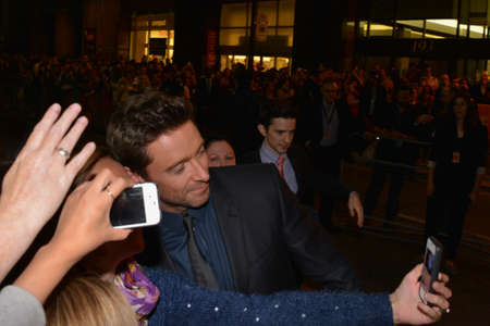 TORONTO - SEPTEMBER 6: Actor Hugh Jackman takes a selfie with fans at the Toronto International Film Festival for his new film Prisoners on September 6, 2013.