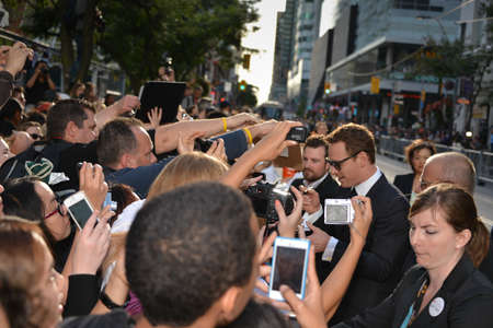 autograph: TORONTO - SEPTEMBER 6: Actor Michael Fassbender signs autograph at the Toronto International Film Festival for his new film 12 Years a Slave on September 6, 2013.