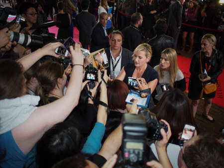 TORONTO - SEPTEMBER 7: Actress Kate Winslet signs autographs for fans at the Toronto International Film Festival for her new film Labor Day on September 7, 2013.
