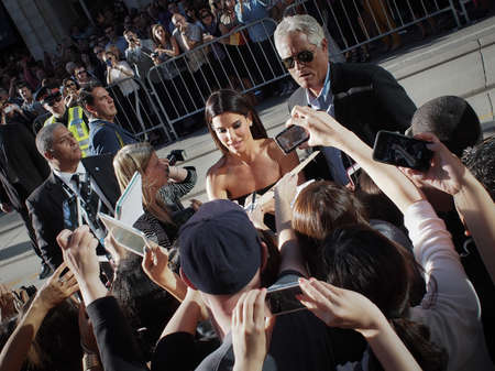 TORONTO - SEPTEMBER 8: Actress Sandra Bullock signs autographs for fans at the Toronto International Film Festival for her new film Gravity on September 8, 2013.