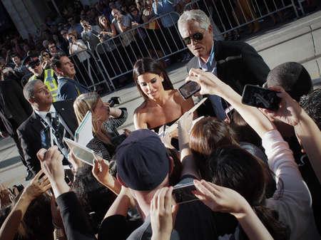 TORONTO - SEPTEMBER 8: Actress Sandra Bullock signs autographs for fans at the Toronto International Film Festival for her new film Gravity on September 8, 2013.