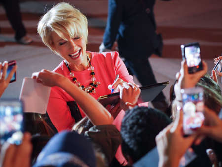 autograph: TORONTO - SEPTEMBER 12: Actress Emma Thompson signs autograph for fans at the Toronto International Film Festival for her new film The Love Punch on September 12, 2013.