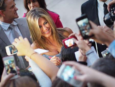 TORONTO - SEPTEMBER 14  Jennifer Aniston signs autographs for fans at the Toronto International Film Festival for her new film Life of Crime on September 14, 2013