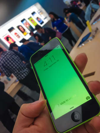TORONTO - SEPTEMBER 20  Custormer holds an iPhone 5c at the Apple Store in Toronto, Canada on September 20, 2013  Apple's newest iPhones, the 5C and the 5S go on sale across Canada and in several other countries this day