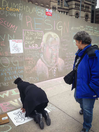 TORONTO - NOVEMBER 16  Protester against the Mayor Rob Ford writes on the floor in Toronto, Canada on November 16, 2013