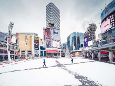 TORONTO - DECEMBER 25: People pass by the Yonge & Dundas Square in Toronto, Canada on December 25, 2013.