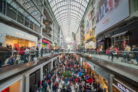 boxing day: TORONTO - DECEMBER 26: Shoppers visit the mall in Toronto, Canada on the Boxing Day, December 26, 2013. Editorial