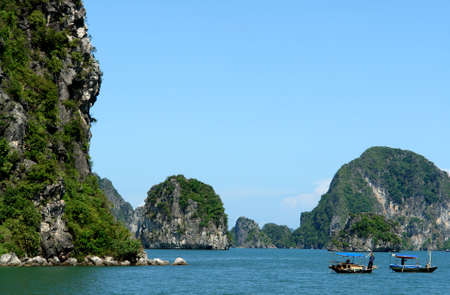 Small boats in Ha Long Bay Stock Photo