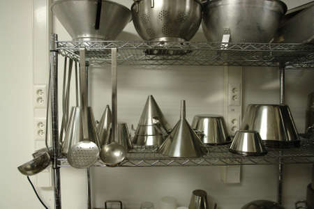 Rack with professional kitchen material Stock Photo - 714333