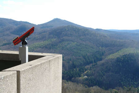 Telescope binoculars on a building in the Mountains to view the valley into detail      photo