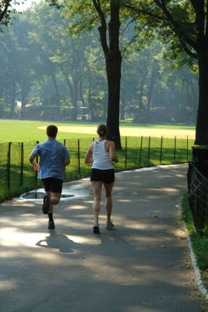 Couple jogging in central park new york city