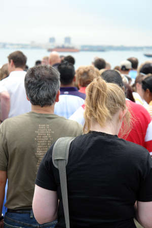 Waiting line with a woman and a man in front
