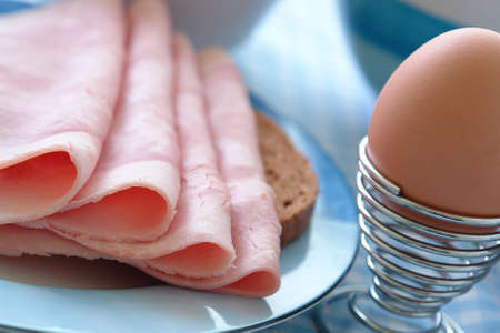 Powerful breakfast with a loaf of bread and ham and eggs Stock Photo