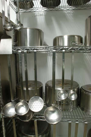 Rack with professional kitchen equipment