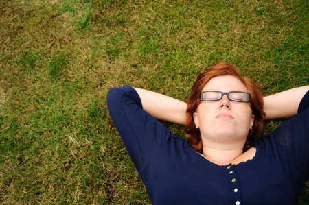 Beautiful young woman relaxing in the grass Stock Photo - 5530598