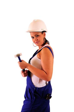 Young woman with hard hat and tools on white background Stock Photo - 10063292