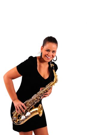 Young woman with saxophone on white background photo