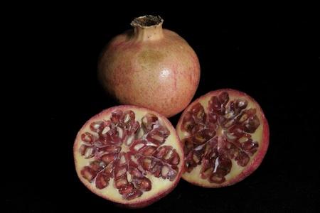 cortado: Fruta de la granada primer plano, cortado â €