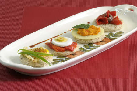 Tasty bread slices, with eggs, peppers and pate photo