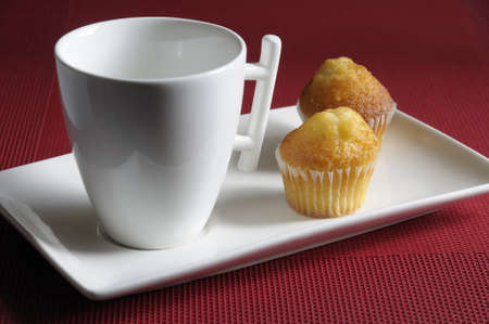 Breakfast pastries and a cup of milk photo