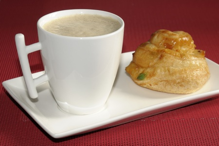 madalena: Breakfast pastries and a cup of milk