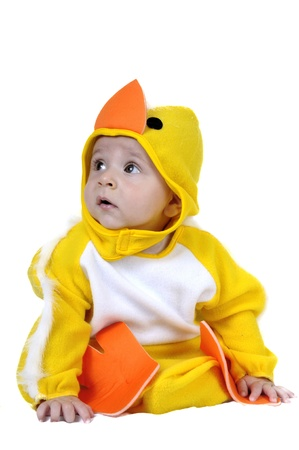 Baby dressed in a baby chicken costume