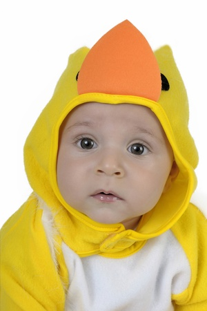 Baby dressed in a baby chicken costume photo