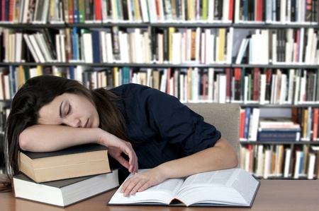Tired teenager, sleeping on the books Stock Photo