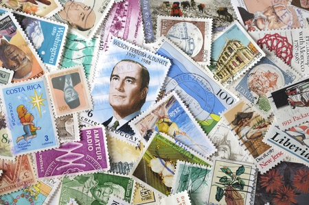 Different postage stamps as background