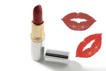 Red lipstick with a kiss on white background photo