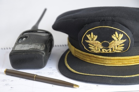 Flight plan and airline pilot hat