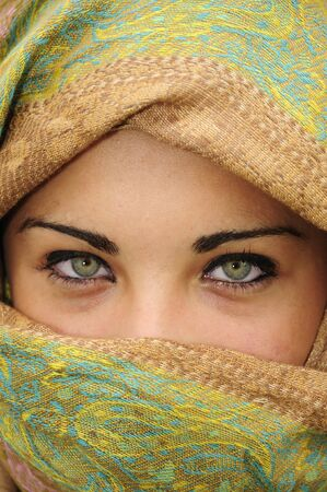 Beautiful girl with scarf around her head