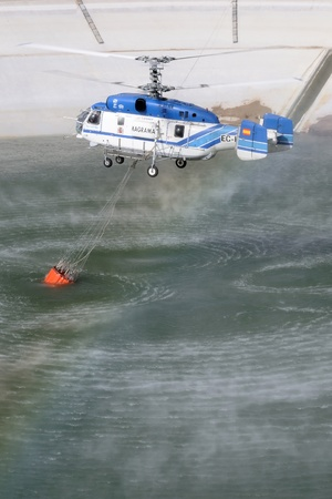 drain fly: SANTA CRUZ DE TENERIFE, AUGUST 3  Fire fighting Helicopter Kamov KA-32a-11BC, with bambi basket, during a fire fighting in the bush  August 3, 2013, Tenerife  Canary Islands  Spain