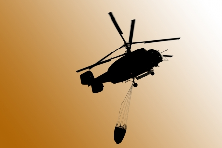 drain fly: Helicopter extinguishing a forest fire Stock Photo